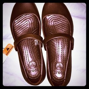 Brand New Croc Sandals with tags size 9W.